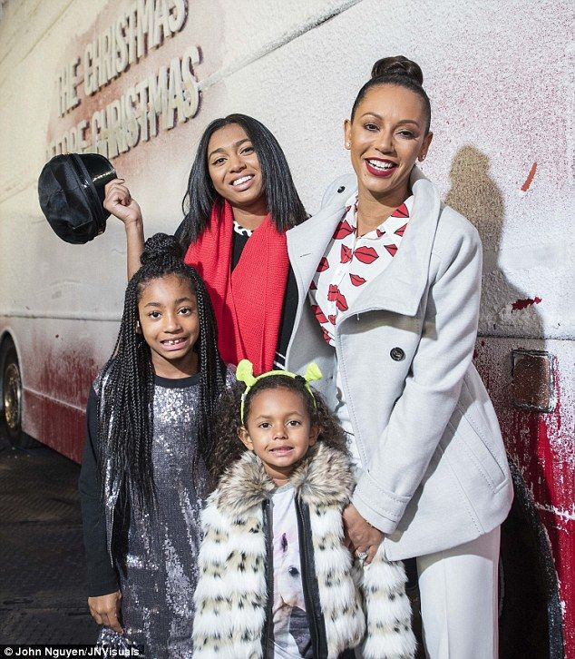 Family portrait: Mel B took her daughters Phoenix, 16, Angel, eight, and Madison, four, for a spin on the Westfield Christmas Before Christmas Bus on Monday