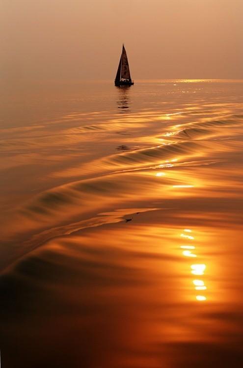 Ocean sunset...better under billowing canvas!