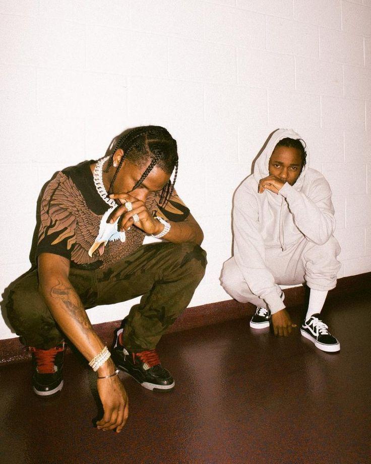 Travis Scott Hangs Out With Kendrick Lamar Wearing Louis Vuitton X Supreme Pants, Air Jordan Sneakers And Vintage Blue Eagle T-Shirt