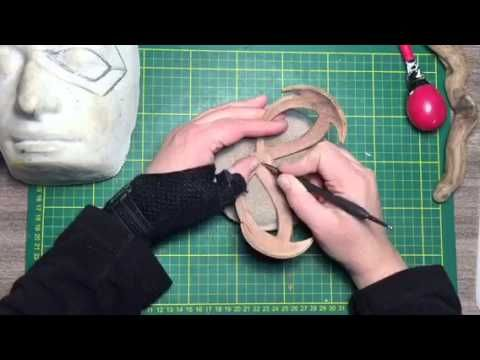 Sculpting a leather mask                                                                                                                                                     More