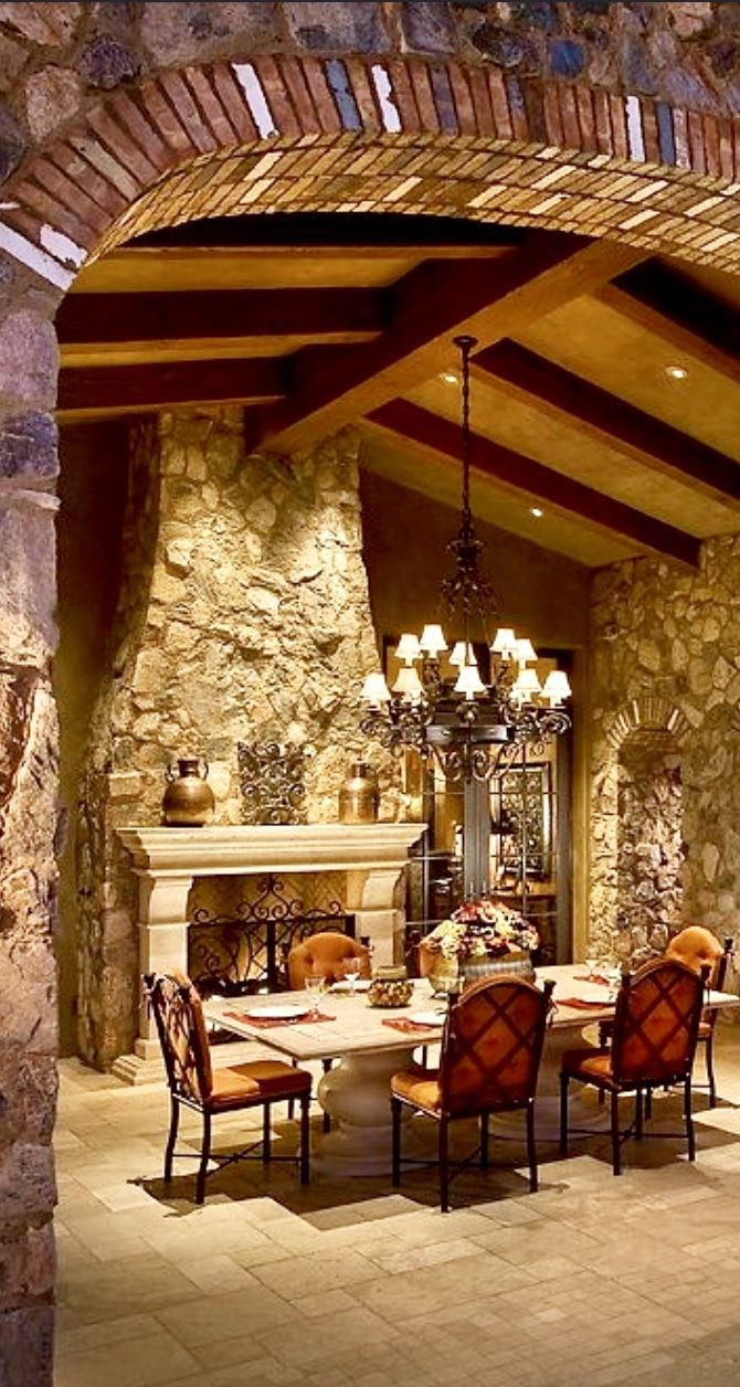 outdoor dining tuscan architecture stone & iron