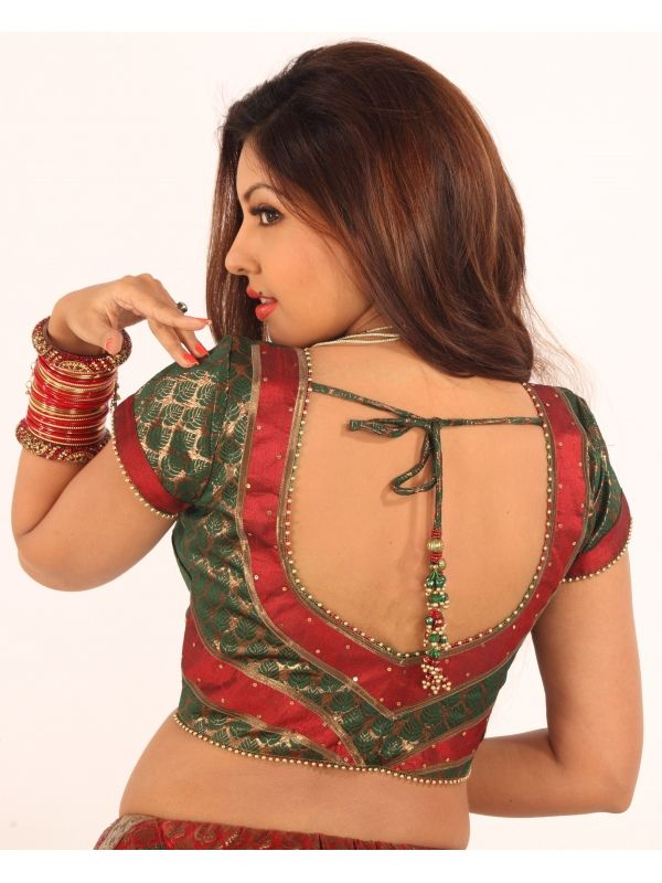 Traditional Maroon net chaniya choli with brocade green blouse
