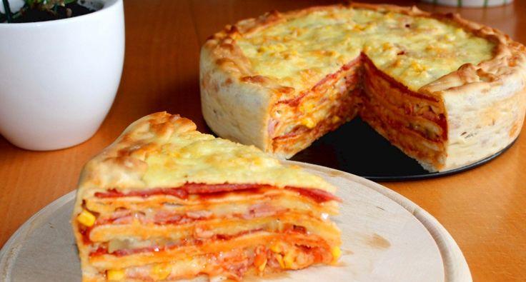 Pizzatorta recept: Ez az étel nem kifejezetten a kalóriaszegény kategóriába tartozik, de aki szeretne egy igazán jót enni, az feltétlenül próbálja ki ezt a pizzatorta receptet! :)