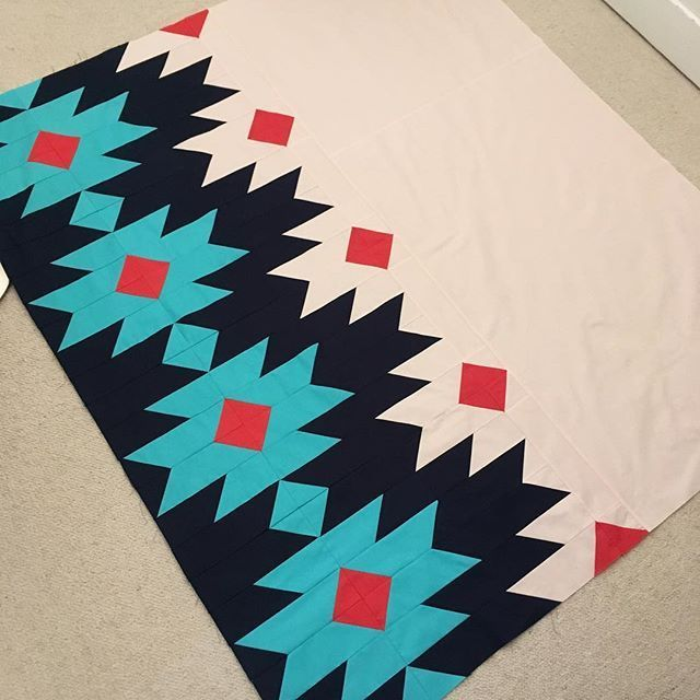 """This quilt top came together in an afternoon. The pattern is called """"Phoenix"""" by @purplepineapplestudio which obviously attracted me because Phoenix is a second home to me. Now, how to quilt it? I'm wondering about thread color Maybe different ones, light and dark?"""