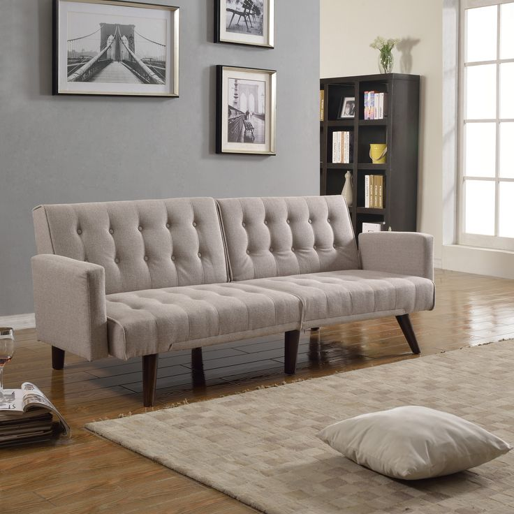 Small space comfortable sleeper futon with split-back for individual preference, features dark wood detachable legs and arm rests.