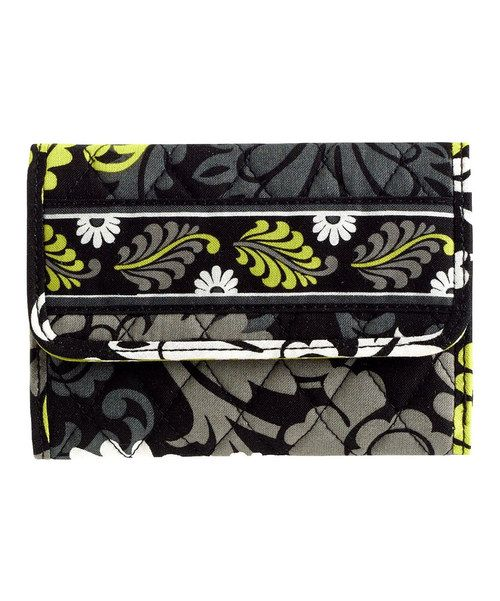 Compact yet spacious, this modern wallet redefines traveling in style. Boasting one of Vera Bradley's highly coveted retired patterns, this wallet also features an expanded bill compartment to fit European currency. Note: This item features a retired pattern.