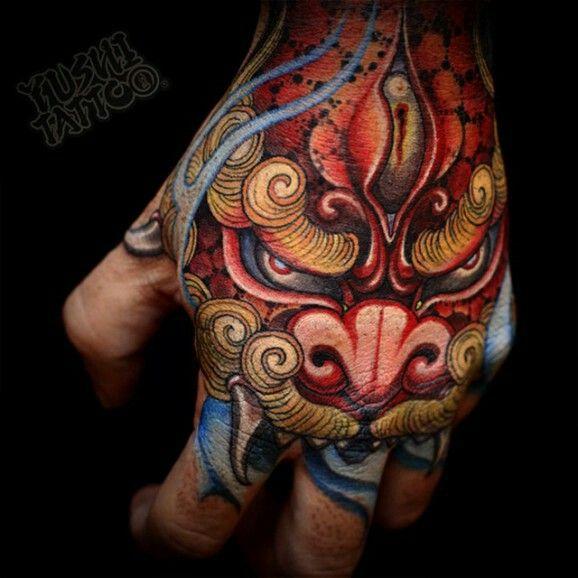 Foo dog hand tattoo
