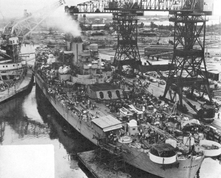USS Alabama at Norfolk Naval Shipyard, Portsmouth, Virginia, United States, Feb-Aug 1942; note Crane Ship No. 1, former battleship Kearsage, servicing Alabama