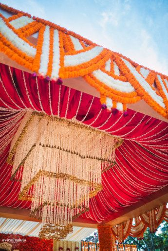 orange red and white mandap, floral chandelier, square chandelier