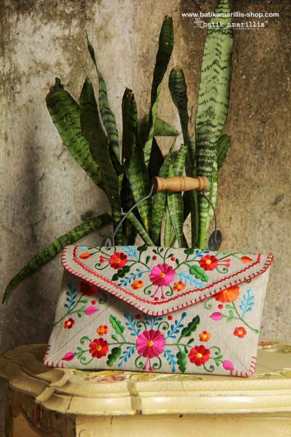 Batik Amarillis Made in Indonesia. Batik Amarillis's frida clutch Our super Chic embroidery clutch,features mexican embroidery on cotton canvas which lined with Lurik Surjan Yogjakarta.