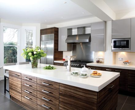 Hi gloss acrylic and walnut furniture with Latte Caesterstone and walnut worktops