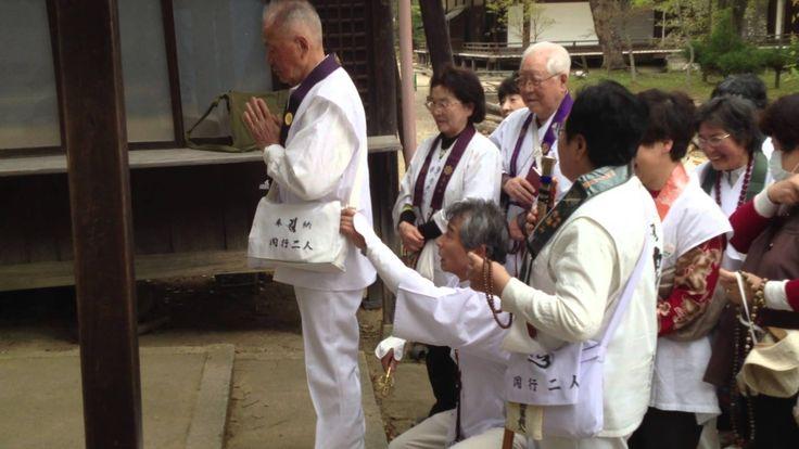 Prayers at Ninna-ji Temple, Kyoto, Japan. Part back massage, part a prayer for good health!