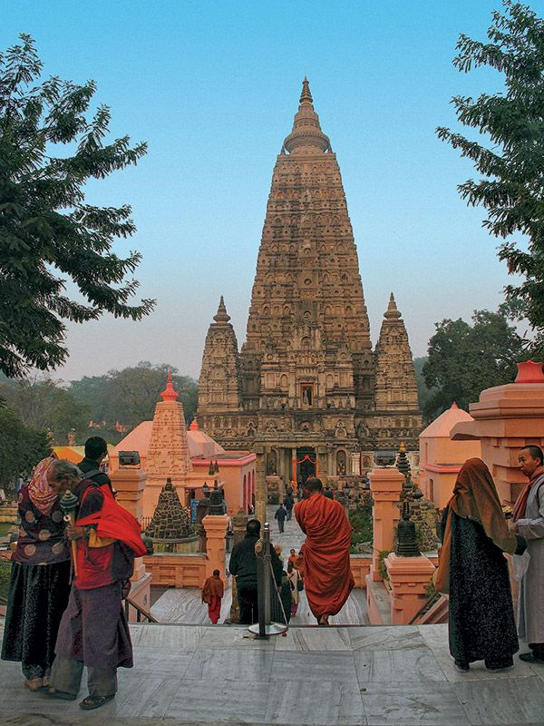 The Mahabodhi temple at Bodhgaya still stands at the place of enlightenment. At dawn, when this picture was taken, many pilgrims are already approaching the sacred precinct. #Buddhism
