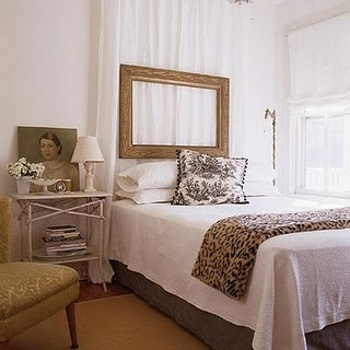 curtain headboard idea... i like how they hung an empty frame from the rods