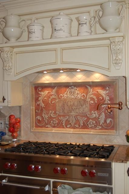 Tile design behind stove... not to mention the pot water filler. Love that!