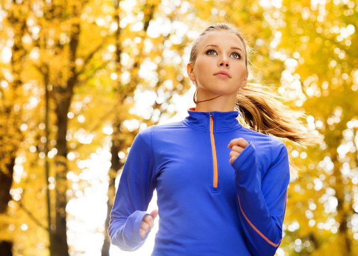 Runner - Bautiful running woman jogging in autumn nature