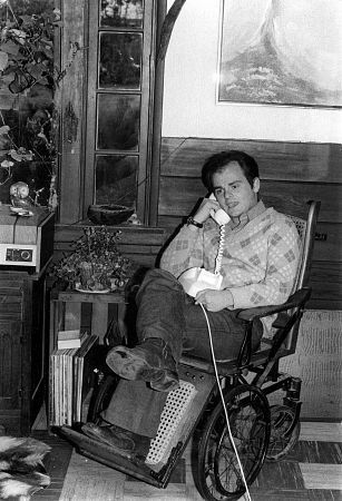 Gary Burghoff at home in an antique wheelchair C. 1973