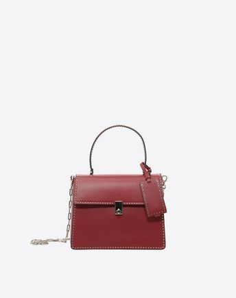 Are you looking for Valentino Garavani Handbag? Find out all the details at Valentino Online Boutique and shop designer icons to wear.