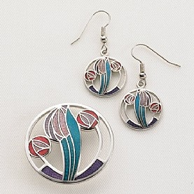 £16.99 Glasgow Style Brooch & Earrings  Rhodium-plated jewellery with vitreous enamel accents in The Glasgow Style, recalling the subtle curves and rose motifs prevalent in the work of Charles Rennie Mackintosh (1868 - 1928).