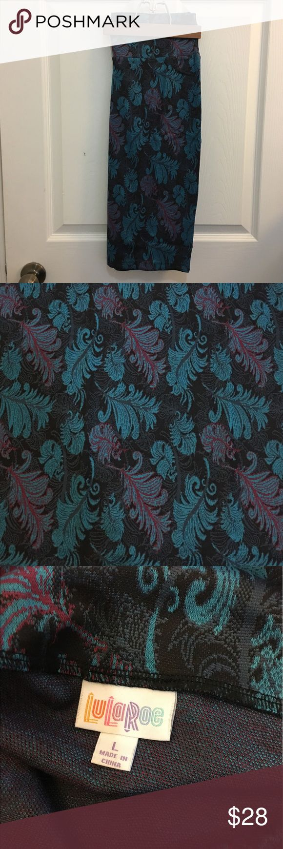 LuLaRoe L Cassie NWOT Large LuLaRoe Cassie Skirt. Black with robin's egg blue and magenta scrolling leaf pattern. Never worn! LuLaRoe Skirts Pencil