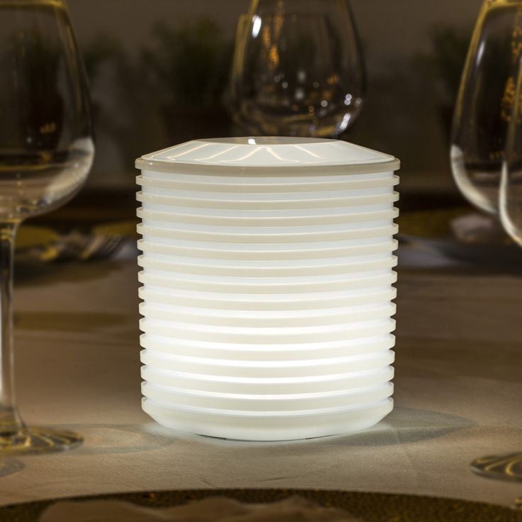 A traditional paper lantern reimagined, the Lantern LED Indoor Outdoor Lamp's durable Polyethylene construction won't get soggy if it's left out in the rain. http://www.ylighting.com/blog/top-10-led-outdoor-table-lamps-giveaway/