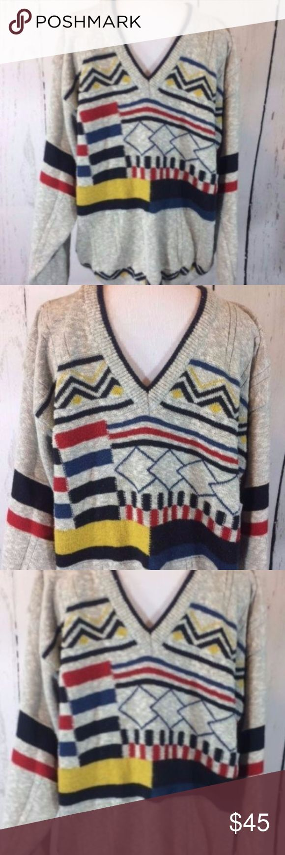 """Vintage Men's V Neck Sweater Western Germany This is not an Ugly Sweater!! BUT it is pretty fun and funky  Men's L V- Neck Sweater Maremma Geometric Made in Western Germany Eu Sz 50  cotton blend, not too heavy or hot, just right really sharp piece with great modernist colors and print  Chest flat font pit to pit 24"""" Sleeve 25"""" Total Length 27"""" Between Back Shoulder Seam 24"""" Maremma Sweaters V-Neck"""