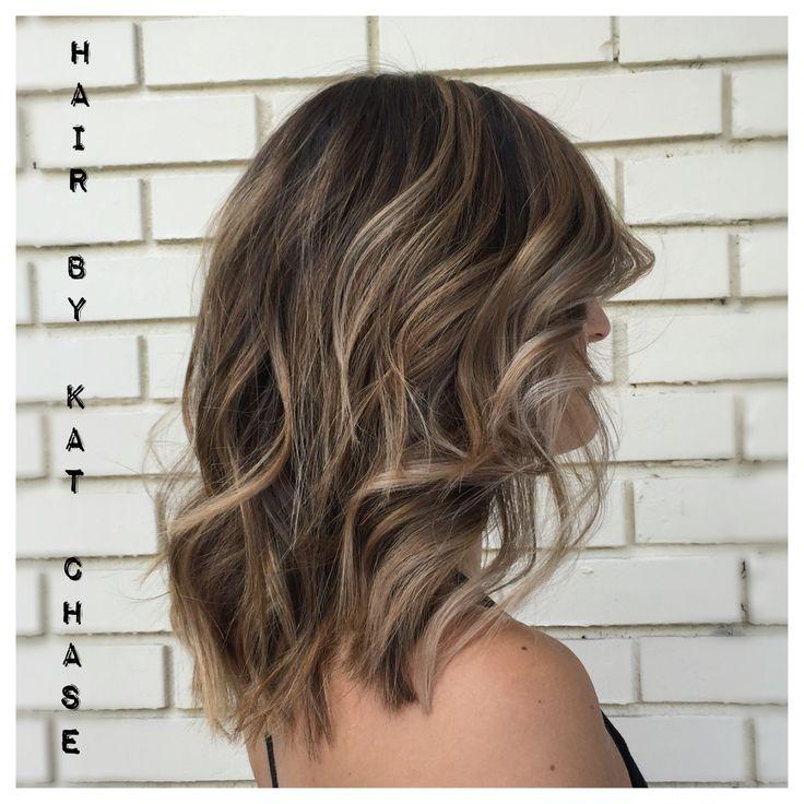 Ash blonde balayage highlights on medium hair