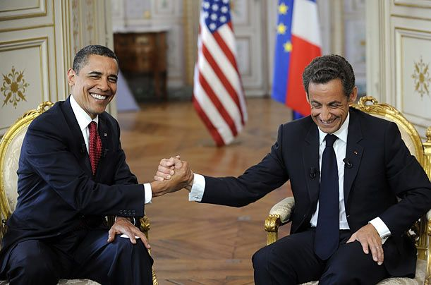 President Barack Obama (L) shakes hands with Frances President Nicolas Sarkozy during a bilateral meeting at the Prefecture of Caen June 6, 2009.