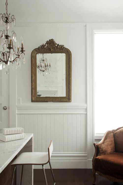 love everything - the mirror, chandelier, the marble counter, the chair and all the colours together.
