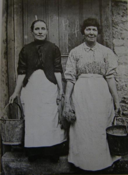 Charwomen in front of a tenement in Dublin, Ireland.  (late 1800's or early 1900's)