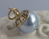 wonderful idea for a wedding shower.  Something blue for the bride.  A handmade charm with the date of the wedding stamped on it, can also have the couples intials and the date ie:12.10.11.