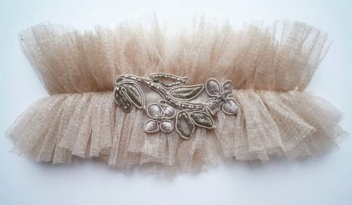 Here is a blog with info on making your own garter, which I love, because some of the store bought ones just looke a little cheesy!