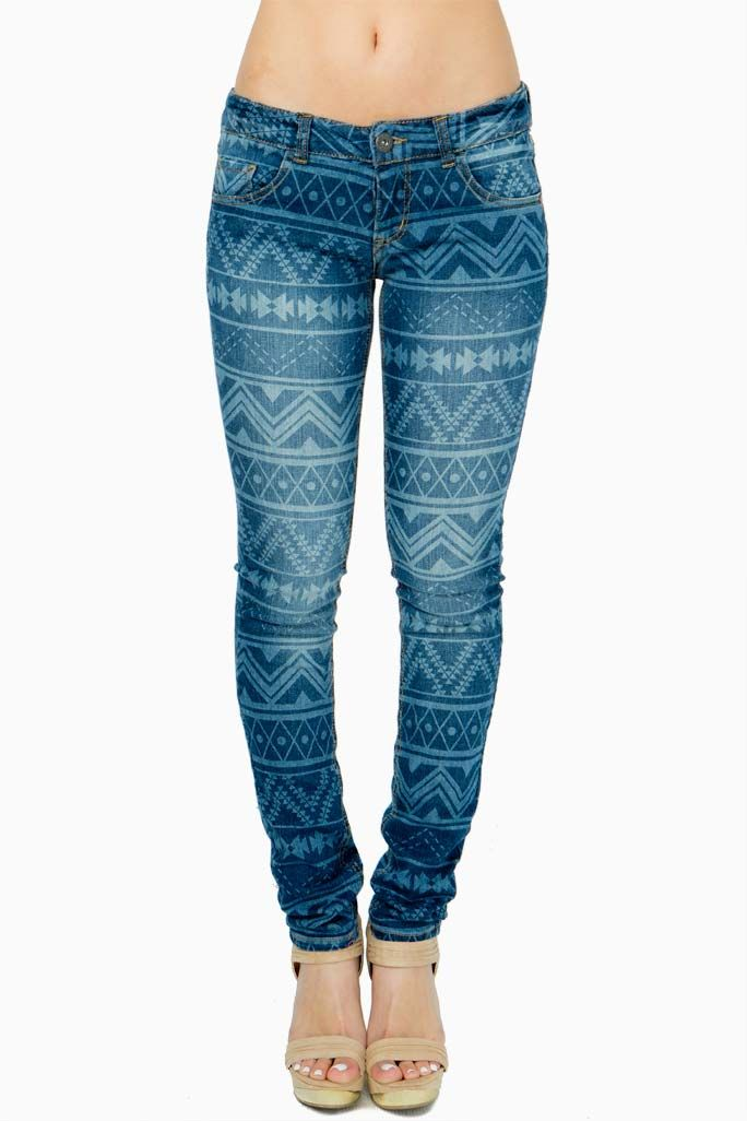 A fresh update to the classic skinnies, these cotton blend jeans feature an allover Aztec-inspired print and contrast stitching. Five pocket styling. Belt loops at the waist. Zip fly. Button front closure.