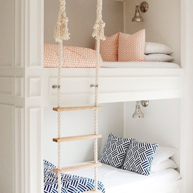 Built-in bunks with a rope ladder and nautical sconces. #cottagestyle #bunkroom #builtin