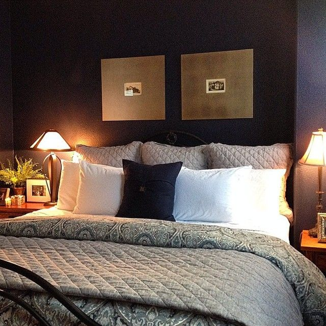 Try a dark accent wall in the bedroom for a cozy and upscale design. This HomeGoodsHappy image is from Instagram.