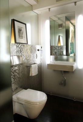 mirror walls + silver tile brighten & enlarge this tiny bathroom.