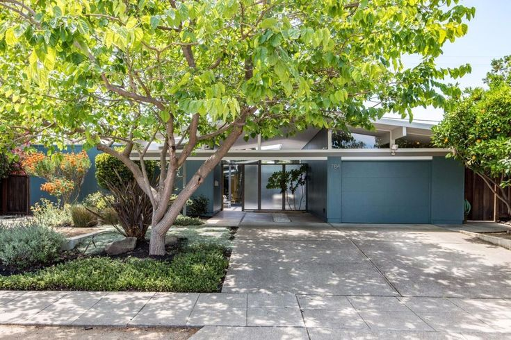 Recently sold: $1,770,000. Refreshingly modern, remodeled Eichler home with lots to love! Welcoming multi-function atrium features Porcelanosa tile floors*Bright open concept living and dining area with wood burning fireplace, floor-to-ceiling glass showcasing views of atrium and backyard*Master suite with walk-in closet and remodeled bath*Gourmet kitchen w. solid wood custom cabinetry, built-in organizers, modern finger pulls and self closing doors/drawers, spacious island w breakfast b...
