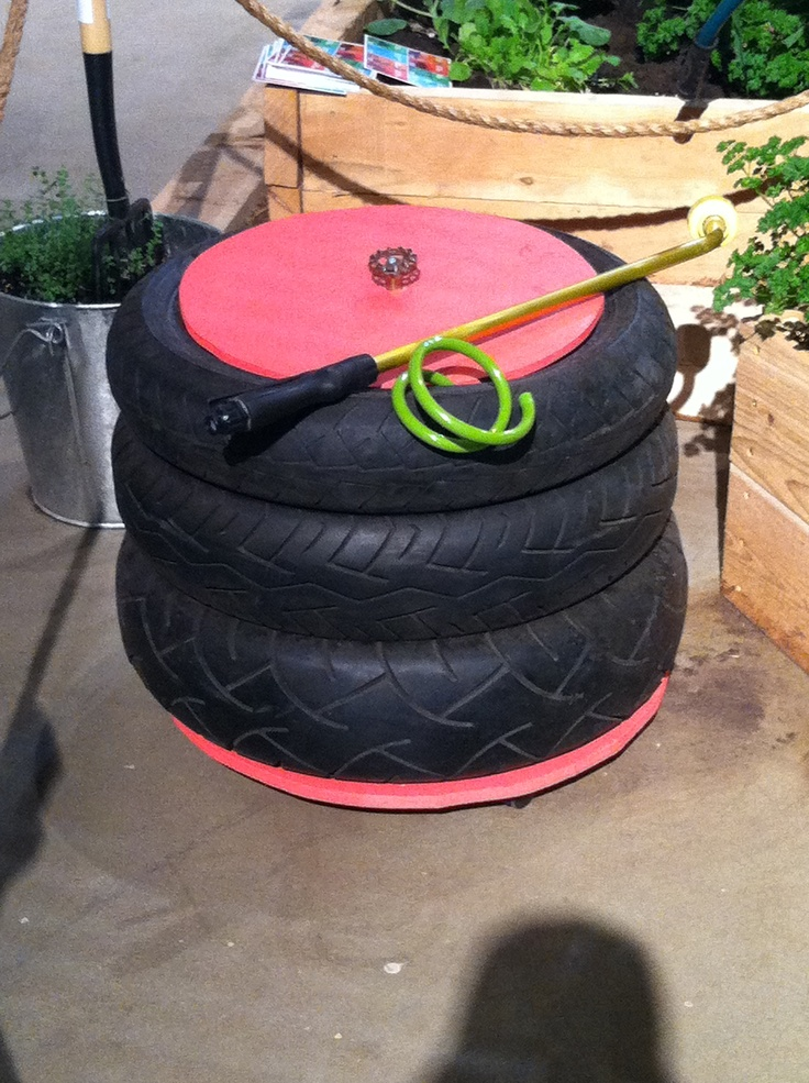Upcycled tires into storage for your hose