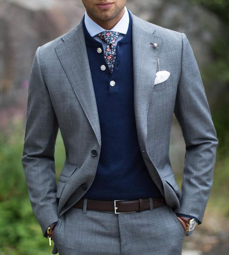 Casual approach yet formal look. The Lecce grey suit paired with a Dark blue henley, Wedgwood cutaway shirt and Dark orange floral tie. #grandfrank  www.Grandfrank.com