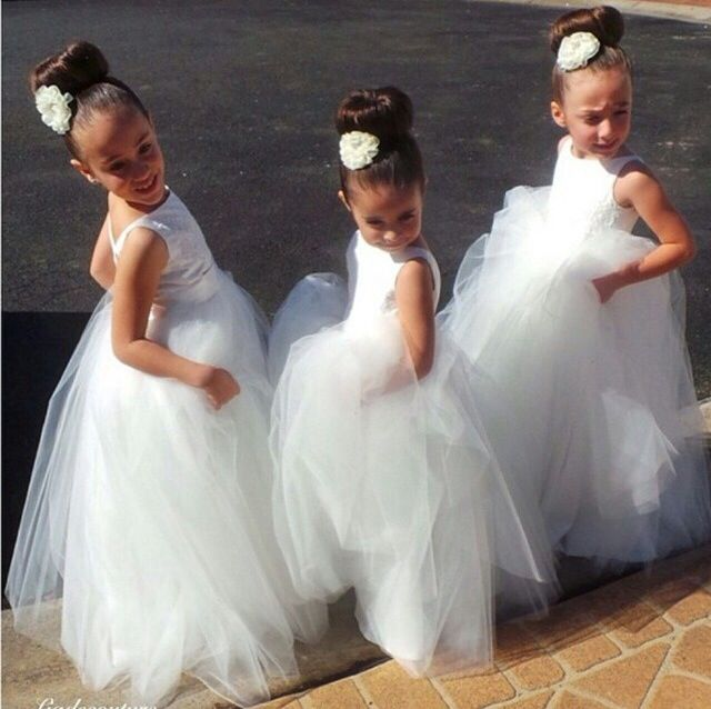 love these white flower girl dresses and the cute too bun hairstyles. <3