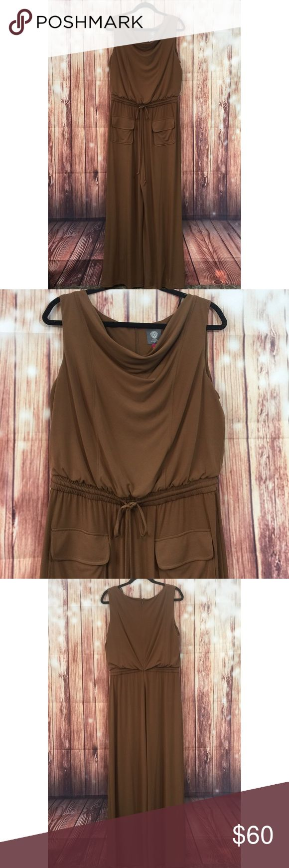 Vince Camuto Jumpsuit Vince Camuto Brown Jumpsuit Sz L . Zip back closure/Cowl neckline/drawstring waist/2 front pockets /wide leg design. Great Condition! No signs of wear .   Shell 95%polyester            5%Spandex Lining 100%Polyester  Measurements are approximate taken with garment laying on a flat surface   Breast 40 inches Waist 30 inches Length from waist 45 inches Length from shoulder 63 inches Leg opening 30 inches Vince Camuto Pants Jumpsuits & Rompers
