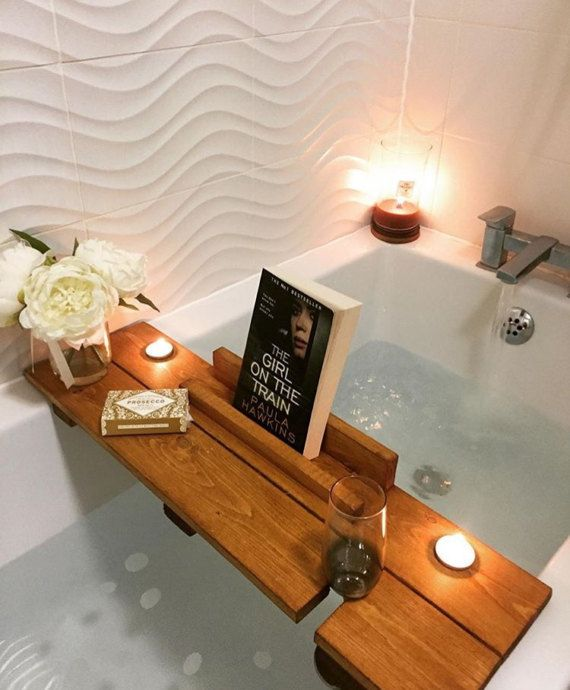 I cannot think of anything better than a good book, a glass of wine and some candles along with a good long soak in the tub! This would be a perfect Mothers Day gift, birthday gift, anniversary gift or just to spoil yourself. Handmade from solid wood, these measure 68cm wide (we can make other sizes) with wooden stops (7cm in from each end) underneath to prevent it from falling in. This is also available in black, please look at the other items in our shop. Its finished in a waterproof oak…