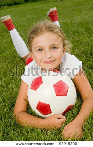 Portrait of little girl soccer player - this is so cute! I may have to take a photo like this myself during next week's soccer photos since her hair will be fixed.
