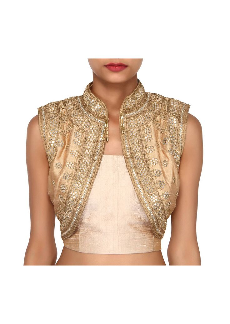 Beige shrug featuring in raw silk.  Its embellished in mirror embroidery.  Slight variation in color is possible.  95% of our customers believe that the product is as shown in the website.