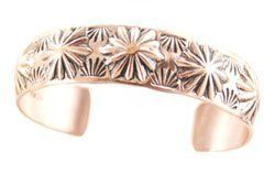 By Navajo Artist: Nora Tahe: Copper Women's Bracelet: Designs will Vary. RICH PEEL. $29.95. By Navajo Artist: Nora Tahe: Copper Bracelet domed with assorted Designs.. Measures 5/8 inch wide.. Comes with makers name on the inside. Comes with a Certificate of Authenticity. Save 33%!