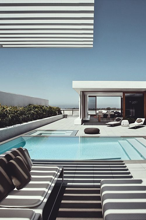 Overflow Pool -  with-black combination pool with steps across the full width of the swimming pool. beatiful detail sun blinds modern. Design furniture. I almost forgot the jacuzzi!!!