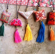 A beautiful dangle in bright color, made to decorate anything you like, your keychain, bag, wall, car....... up to you!! Its made with tassels, vintage fabric, brass beads and a strong waxed cotton co