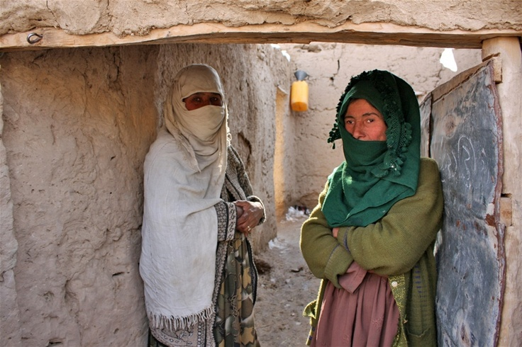 Salima, right, says she has a chronic cough, a blocked nose, and shortness of breath, due to the cold weather. She lives in Arab Aqsai village in Afghanistan's northern Faryab Province, and can't afford a stove to heat her home