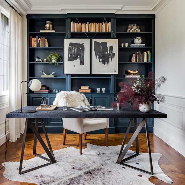 Everything is right where you need it in this modern home office outfitted with handsome navy-coated built-ins. C2 Paint's Espionage (C2_742)