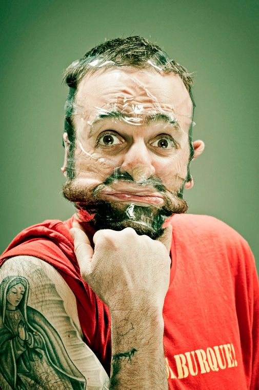 """Scotch Tape"" is an ongoing series of portraits by New Mexico-based photographer Wes Naman in which he uses clear adhesive tape to completely cover and distort people's faces into hilarious caricatures of themselves."